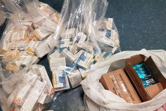 CBP officials say a U.S. citizen planned to sell online Mexican cold and flu medicine seized in a smuggling attempt at the border in El Paso on March 25, 2020.