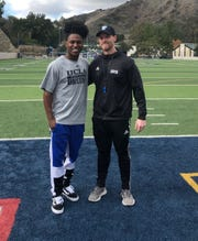 Jeff McCann, right, is the co-owner of Future EliteAcademy in Westlake Village with a number of trainers and athletes, including former Calabasas High and UCLA star Darnay Holmes, left.