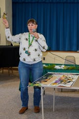 Doris Morgan of Ned's Honey, LLC, in Millville, spoke to members of the Millville Woman's Club about honey and beekeeping.