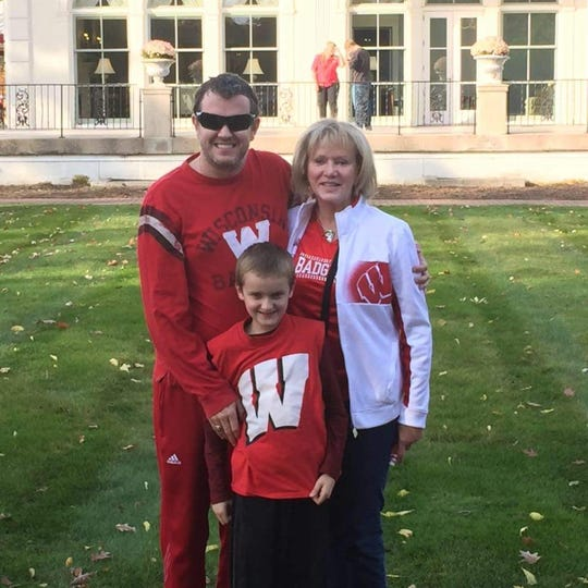 Sue Baumer, right, with her son, Tate Baumer, and grandson, Jack Baumer. She was a regular fixture at Badgers football and basketball games.