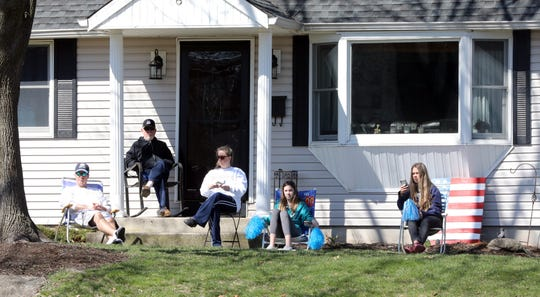 The Thyberg family's three children are now in high school and middle school but they remain connected to RP Connor Elementary. They waited for teachers to drive through in a car parade in Suffern March 26, 2020.