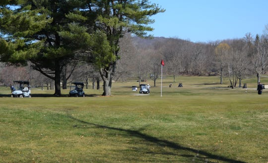 There were eight carts scattered about two holes at Putnam County Golf Course in Mahopac on March 26, 2020. To limit the spread of the coronavirus, some local courses have banned carts while others have mandated single riders.