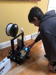 Joe Bockrath, a Brandywine High School engineering student, works on one of the designs to make masks to help health care providers battling the coronavirus pandemic in Delaware.
