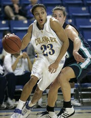 Tyresa Smith (left) cuts to the basket in front of UNC-Wilmington's Becca Papach in a 2007 game at the Bob Carpenter Center.