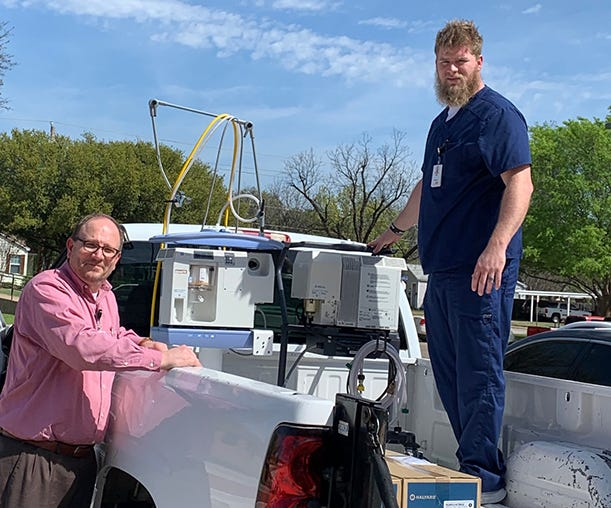 Darrin French, Director of Respiratory Care Services, Neurodiagnostics, and Pulmonary Rehab at United Regional, and Jeff Holden, Biomed Technician, United Regional, load two ventilators and supplies into a truck. The items were loaned from MSU Texas Respiratory Care Services on Thursday, March 26, 2020.