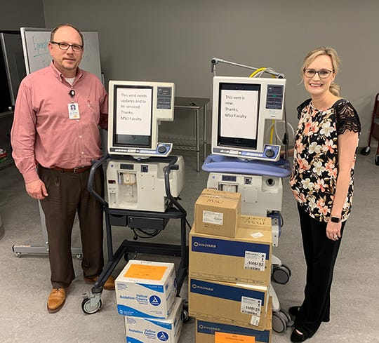 Darrin French, Director of Respiratory Care Services at URHCS, and Jennifer Anderson, Department of Respiratory Care Chair at MSU Texas, stand with two ventilators on loan to URHCS and personal protective equipment which was donated.