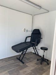 An XCaliber advanced medical assessment pod contains two self-contained exam rooms (one seen here) that have their own heating/cooling and ventilation systems.