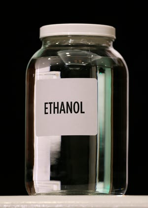 A jar of ethanol fuel sits on display during the Iowa Renewable Fuels Association meeting in Altoona, Iowa. As hospitals and nursing homes run out of hand sanitizer to fight off the coronavirus, struggling ethanol producers are eager to help.