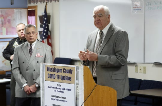 Dr. Jack Butterfield, medical director of the Zanesville-Muskingum County Health Department, urges people to continue to practice social distancing and wash their hands frequently to reduce the chances of spreading COVID-19 in Muskingum County during a press conference on Thursday.