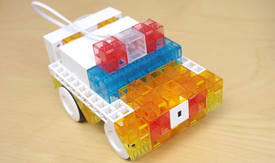 One of the first robots you can build with the Sony KOOV Trial Kit is a police car with a siren that can avoid bumping into objects.