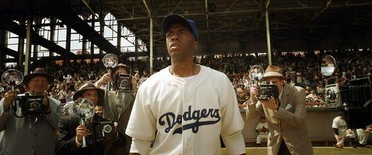 "Chadwick Boseman stars as baseball legend Jackie Robinson in ""42."""