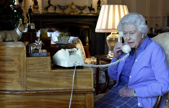 Queen Elizabeth II speaks to Prime Minister Boris Johnson from Windsor Castle for her weekly audience with the leader of her government, on March 25, 2020.