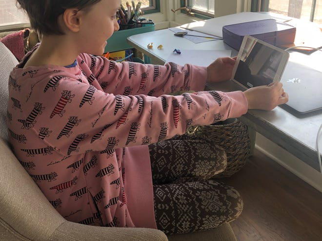 "Every afternoon Flora, 9, and Kate, 10, turn on their laptops and iPads to collaborate on a play called ""World War III,"" a futuristic tale of two sisters who try to save the world after being blown back in time by a bomb."