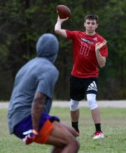 Grayson Loftis, a rising sophomore at Blue Ridge High School, passes to Deiondre Overton, former Clemson Tiger receiver practicing before the NFL Draft, during a practice held by Ramon Robinson, Founder and President of the South Carolina non-profit company Elite Position Training (EPT) and RR Elite QB Academy in Piedmont.