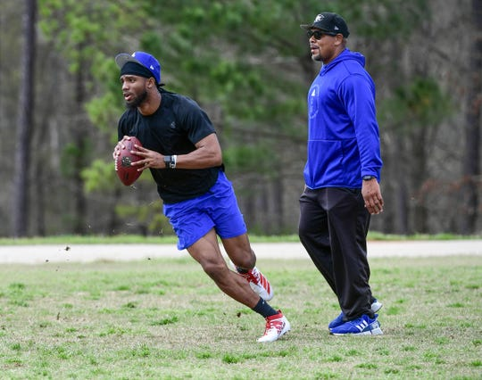 Kelly Bryant, former Missouri quarterback passes a ball during a practice near Ramon Robinson, right,  Founder and President of the South Carolina non-profit company Elite Position Training (EPT) and RR Elite QB Academy workout in Piedmont.