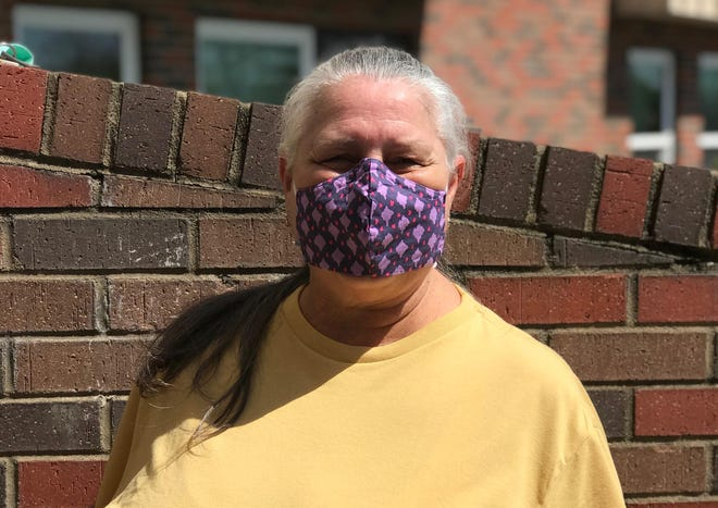 Brenda Dickens, a resident at Our Lady's Manor, wears one of the face masks made by Ashley Ammons Haggart.