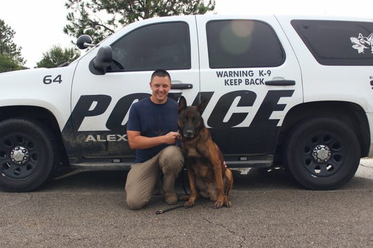 Cpl. Griffin Pirtle and his former partner, K9 Sidney, pose for a photo. Sidney has been retired and, pending approval of the Alexandria City Council, soon will work full time as family pet.