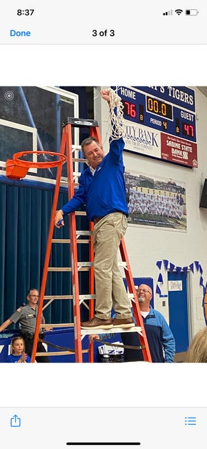 St. Mary's coach Tom Collins cuts down the nets after the Lady Tigers defeated Metairie Park Country Day in the Division IV semifinals. Collins is the 2020 All-Cenla girls basketball Coach of the Year.