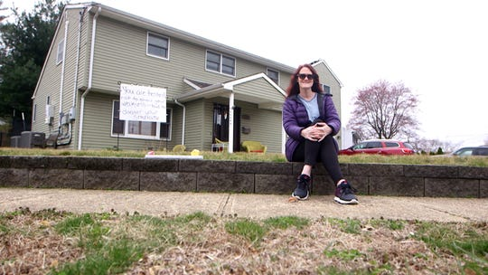 Robyn Badgley of Hazlet writes messages on her front lawn sign, that inspire the public