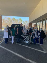 Staff members of Jack and Mike's Restaurant Bar and Grille donate food to a local hospital in Brick Township