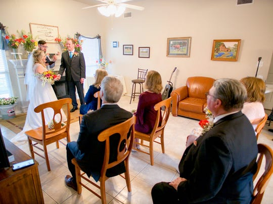 Nathan Adams marries Scott and Sandra Lang March 21. Because of rules regarding gatherings and social distancing, the couple's plans to have a larger wedding with about 150 guests had to change. But 100 people still watched the ceremony through streaming video.
