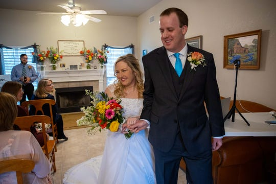 Sandra and Scott Lang walk down the aisle on their wedding day in an intimate ceremony Saturday, March 21. The couple's plans for a larger wedding had to be canceled due to restrictions on gatherings related to the coronavirus.