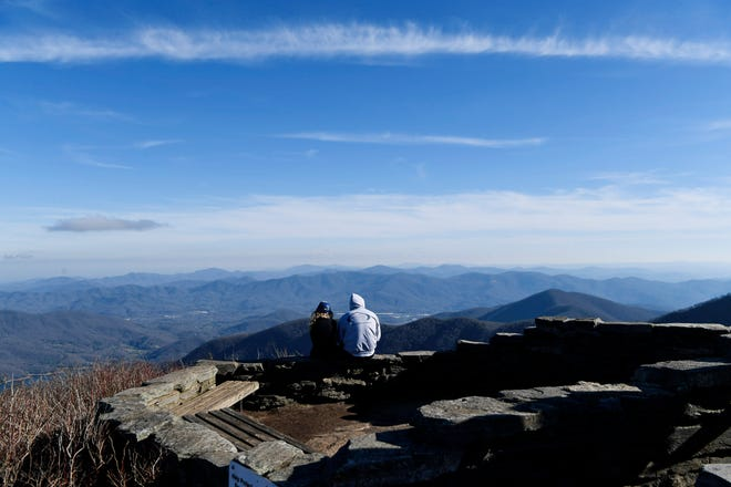A couple enjoys the view at Craggy Gardens along the Blue Ridge Parkway March 26, 2020.