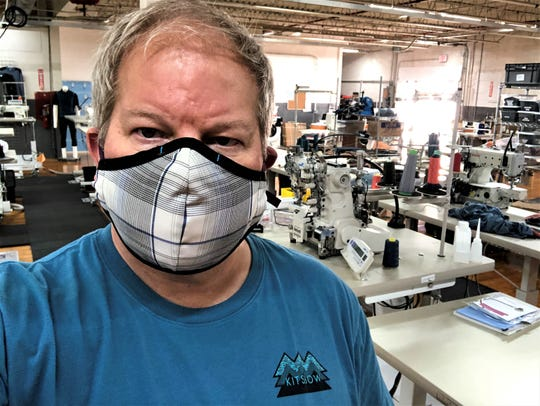 David Billstrom, CEO of Kitsbow Cycling Apparel in Old Fort, models one of the face masks his company has transitioned to producing, with other much needed COVID-19 personal protective equipment.