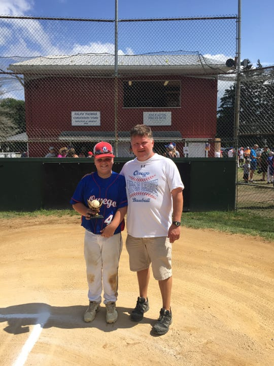 Owego's Scott Rollison, right, seen here with his son Ben, is a Yankees fan who said he watched about 150 games per season.