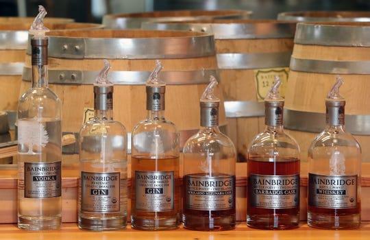 Gin, vodka and whiskey line the shelf in the tasting room at Bainbridge Organic Distillers on Thursday.