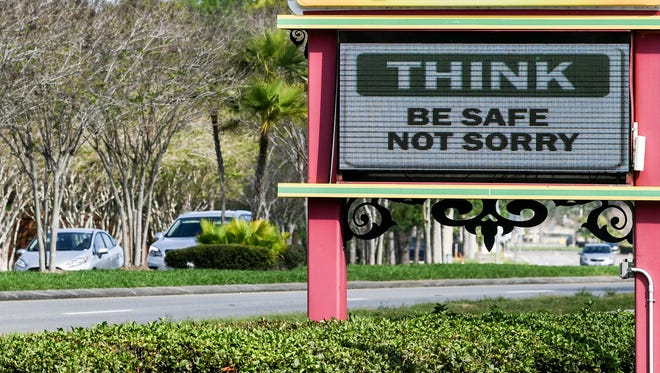 A sign outside Fiesta Azteca restaurant in Suntree, Florida warns people to be more aware of their actions in light of the spread of COVID-19.