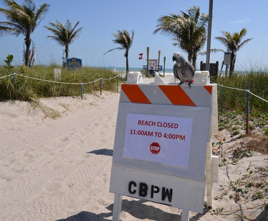 Pictured is the scene at the beach at the end of Minutemen Causeway in Cocoa Beach, at noon March 27. Nobody was on the beach, except for a few Cocoa Beach police officers near the entrance ramp.