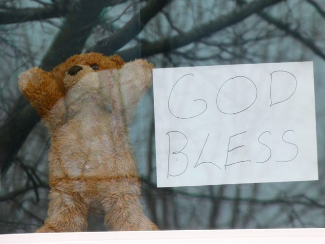 Mr. Bear peers from the window of Stacy Orewiler's home on Wayne Avenue in late March.