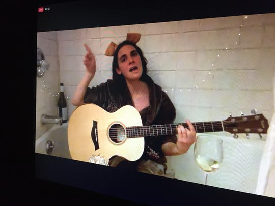Burlington musician Francesca Blanchard sings from her bathtub in this photograph of her live-stream performance on the Facebook page of Higher Ground on March 26, 2020.