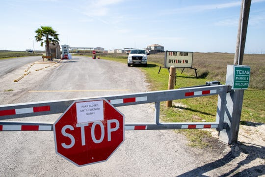 Mustang Island State Park gate is closed after a employee started showing COVID-19 symptoms on Friday, March 27, 2020.