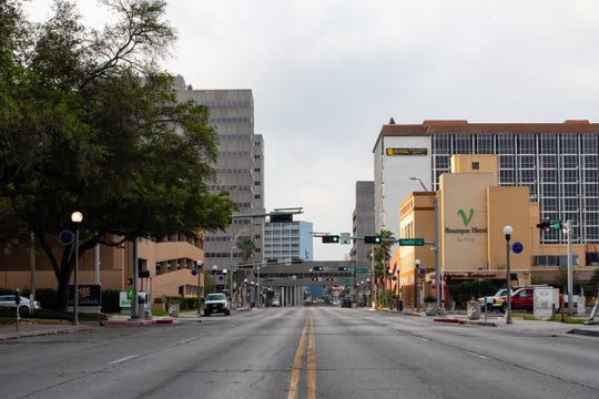 An empty Water Street at 8:30 a.m. in downtown Corpus Christi as the county wide ÒStay at HomeÓ order goes in to affect on Friday, March 27, 2020.