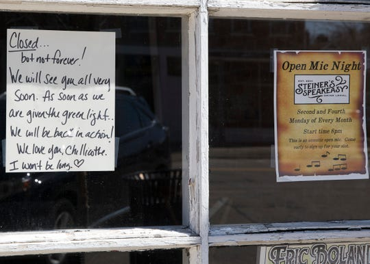 Signs dawn the doors of several Chillicothe downtown businesses either closing the businesses or warning people to not enter if they are showing signs of being sick due to the coronavirus pandemic sweeping Ohio.