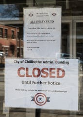 Signs adorn the doors of several Chillicothe downtown businesses either closing the businesses or warning people to not enter if they are showing signs of being sick due to the coronavirus pandemic sweeping Ohio.