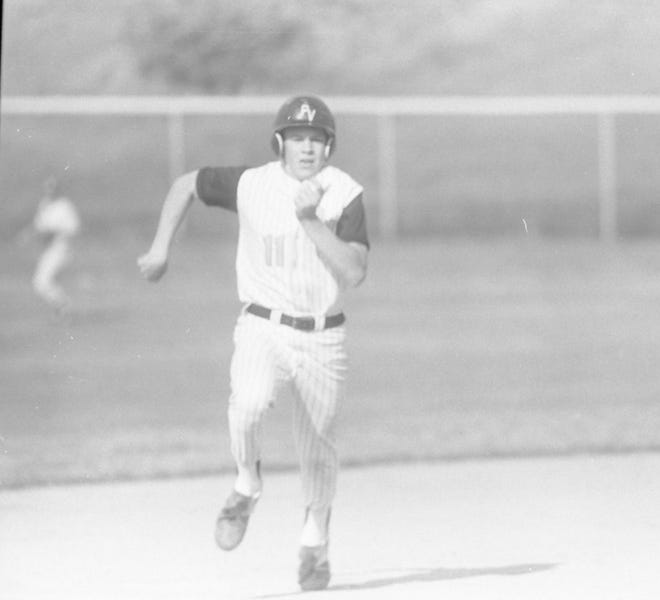 Paint Valley's Jason Mettler rounds third and heads for home to score the first run of the game for the Bearcats.