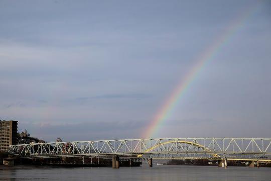 A rainbow is seen over the Ohio River following rain showers, Thursday, March 26, 2020, in Cincinnati.