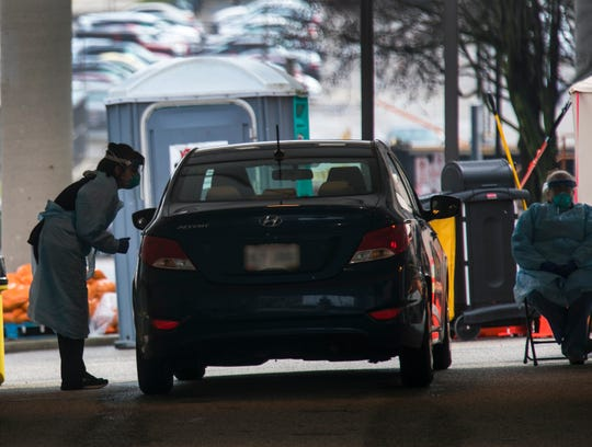 A drive-thru testing site is set up outside UC Health on Burnet Ave., Friday, March 27, 2020. The new coronavirus pandemic has changed the way people are being treated for COVID-19. You still need a doctor's order to be tested and appointment to be tested.