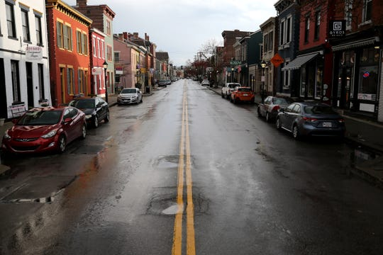 View of Main Street, or Mainstrasse, at about 6:20 p.m. Thursday, March 26, 2020, in Covington, Ky.