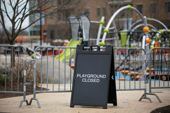 The warm weather brought out a lot of people to Summit Park in Blue Ash Thursday, March 26, 2020, but the playgrounds are now closed due to the new coronavirus pandemic.
