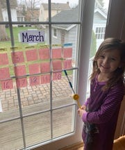 Lincoln kindergartner Sophia Kopec demonstrates a morning calendar activity, a class ritual that is continuing during at-home instruction.