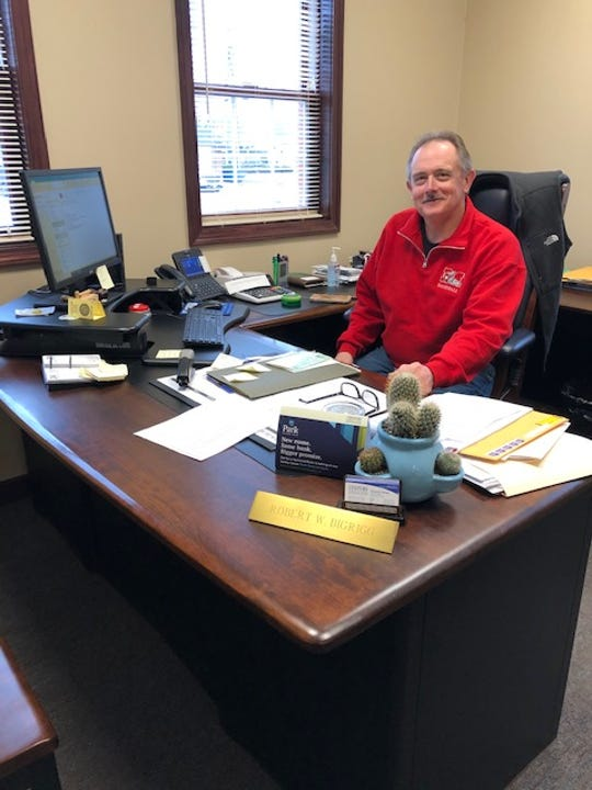 Bob Bigrigg, Commercial Lender at Century National Bank, continues to work at his desk during the COVID-19 outbreak. While employees are in office they are trying to meet with customers through phone call and video options.