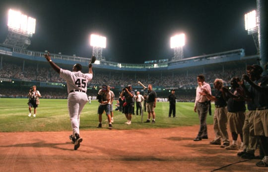 Cecil Fielder waves as the Tigers and Kansas City Royals play the final game at Tiger Stadium in Detroit, Sept. 27, 1999.