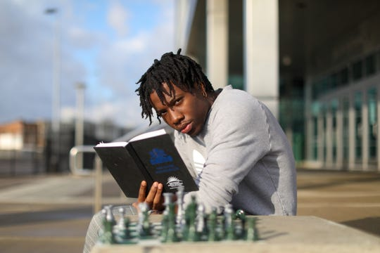 Torrance Henry, 17, of Detroit is a senior at Cass Technical High School, pictured, and after being invited to compete in the US Chess Federation's 2020 National K-12 Championship, Henry will be unable to attend due to the coronavirus, amongst other senior events that will eventually get canceled and is photographed on Friday, March 20, 2020. Henry started playing chess in the 5th grade and has many hopes and aspirations like becoming an electrician with Local 58, getting his CBA at Wayne State University and even modeling.
