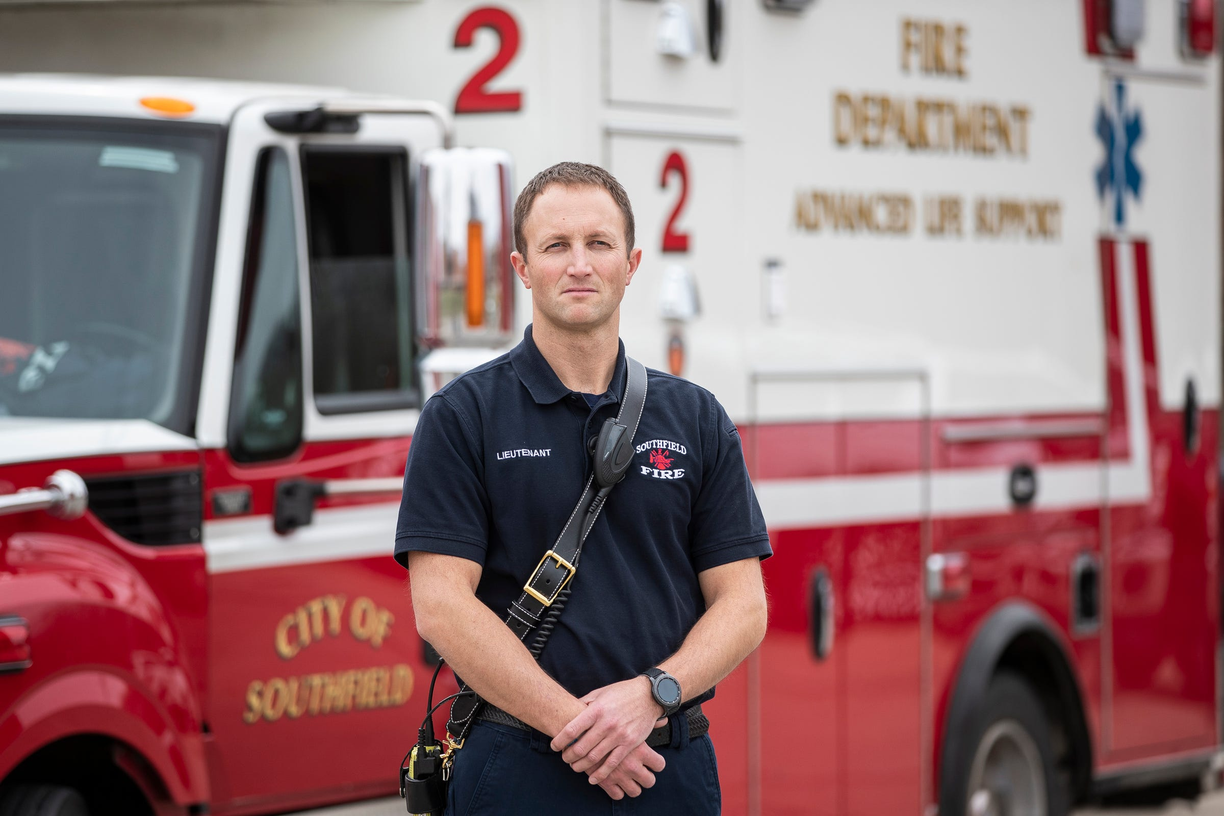 Lieutenant Erik Chesnut poses for a photo in front of his Life 2 vehicle at the Southfield Fire Department headquarter in Southfield, Thursday, March 26, 2020.