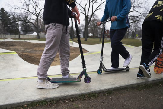 Young adults and kids use this skate park at Donald Red Geary park in Ferndale, Mich. on Thursday, March 19, 2020. Many skate parks like in Clawson, Mich. have closed to the public due to the spread of the Coronavirus.
