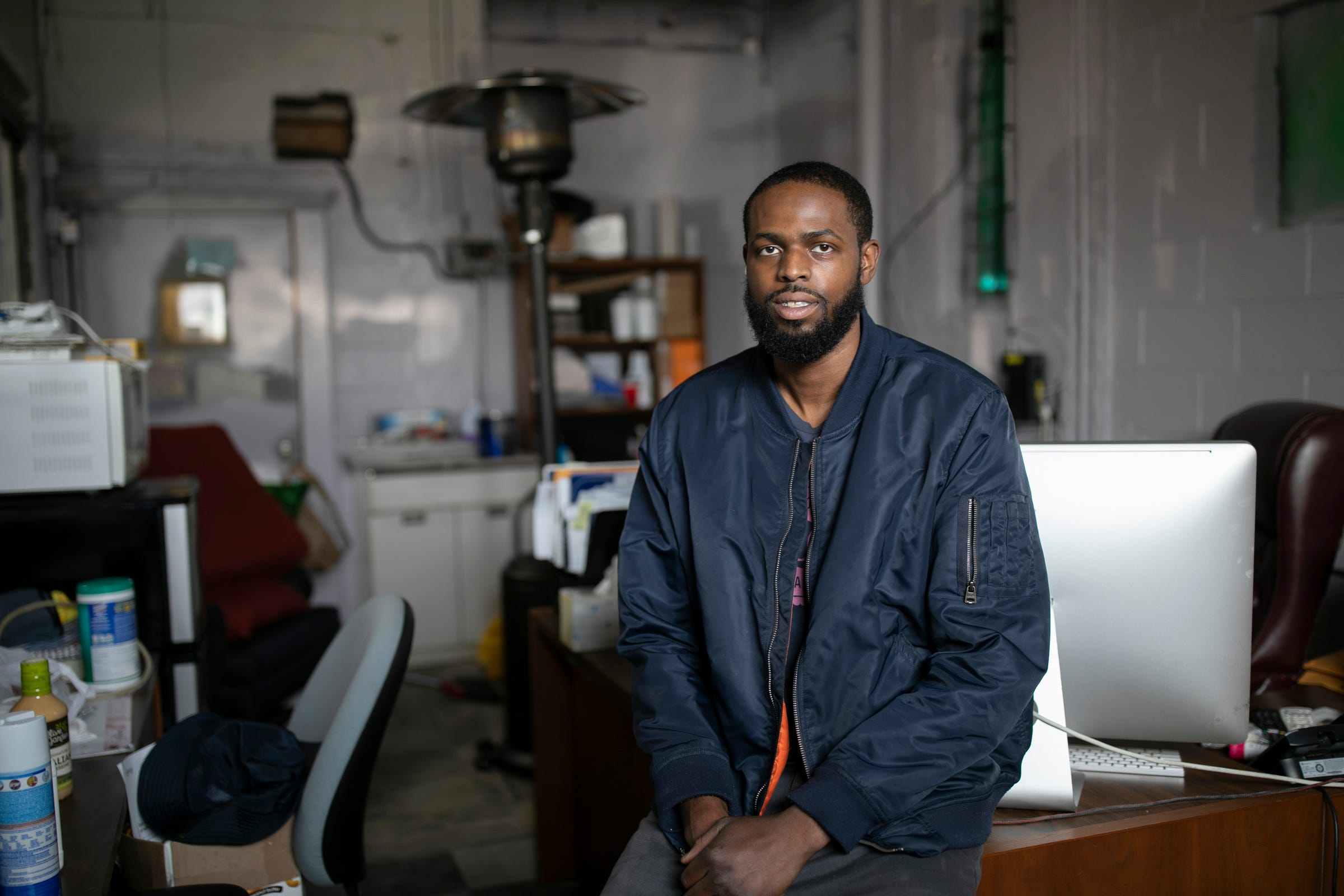 Jerrell Simmons, 27, of Detroit is a detail specialist and a carpet cleaner. Simmons subcontracts for Detroit Maid. Business has become uncertain for Simmons during the Coronavirus threat. Simmons poses for a portrait at his Detroit warehouse Wednesday, March, 25, 2020.
